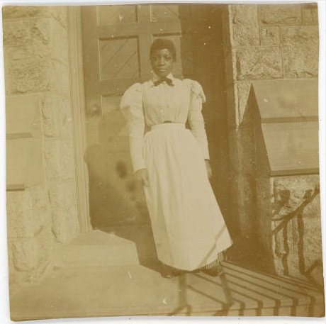 A maid on the steps of Merion Hall, ca. 1898.