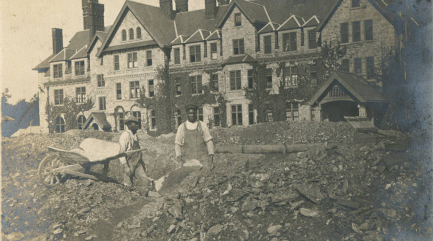 Two laborers working on Merion Hall ca. 1903. | Bryn Mawr College Special Collections, Bryn Mawr, PA.