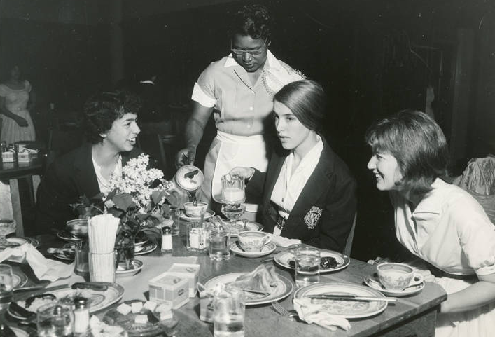 Image of Maid serving students at breakfast ca. 1950s or 1960s. | Bryn Mawr College Special Collections, Bryn Mawr, PA.